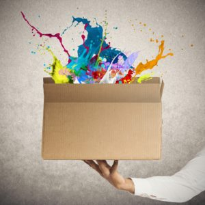 Man holding a creative business box