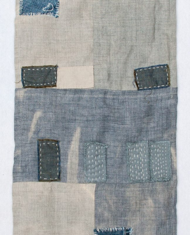 """Las Vegas Foreclosure Quilt"", 2011, 12"" x 36"" Recycled denim, wool, yarn and embroidery thread on bleached linen, copyright Kathryn Clark."
