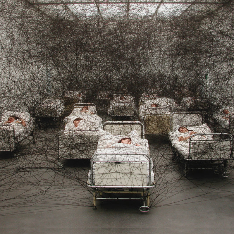 """During Sleep"", 2002, Performance / Installation: hospital beds, bedding, black wool Kunstmuseum Luzern, Lucerne, Switzerland, Photo by Sunhi Mang, © SIAE, Rome, 2020 and the artist"