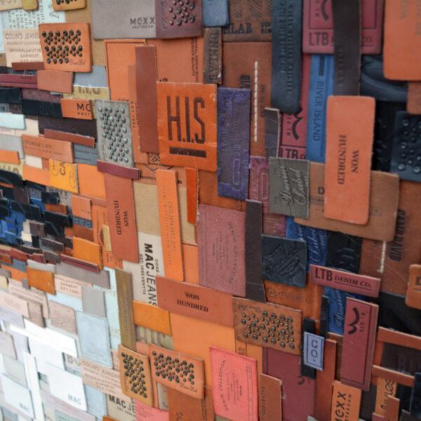 """""""Untitled"""", detail, 2020, leather labels pieces on denim, 120 x 120 cm, ph. Credit Deniz Sağdıç Studio, copyright Deniz Sağdıç"""