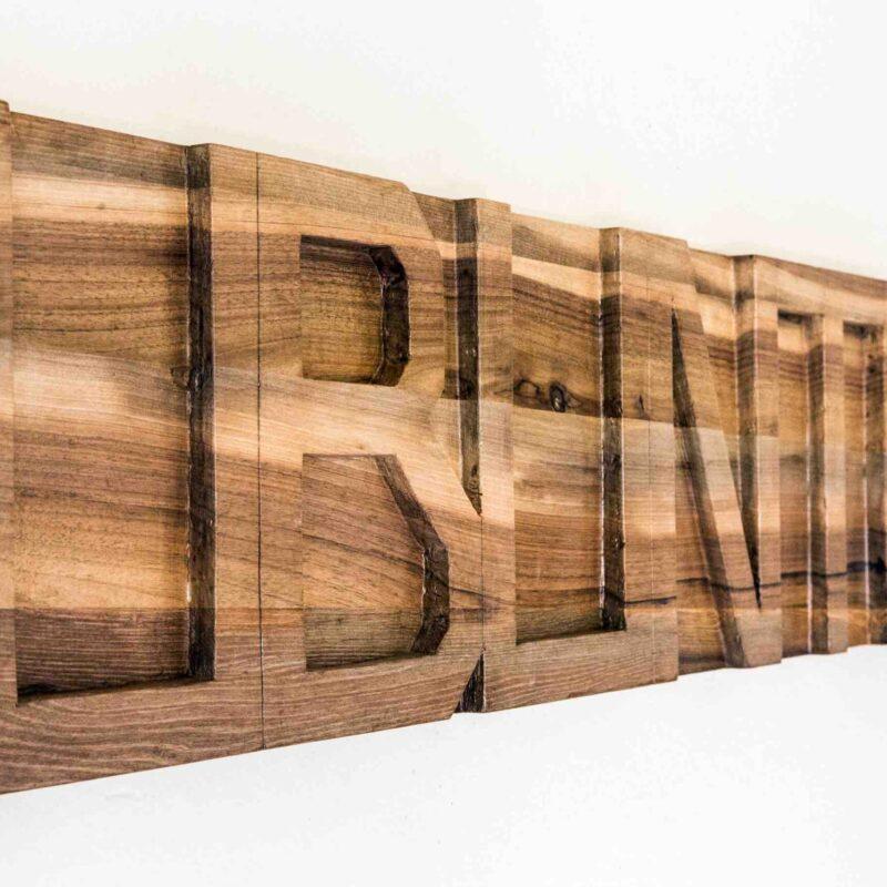 Stefano Boccalini, 2020, La ragione nelle mani – Ubuntu, legno intagliato, 30 x 130 x 4©Christian Tasso