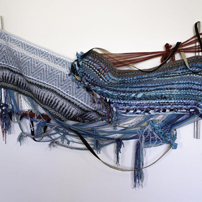 """He says"", 2020, Krokbragd flamepoint rug, rag and braided rug, dog leash, frame bars, 36"" x 54"" x 6"". Image courtesy of the artist, copyright Kira Dominguez Hultgren"