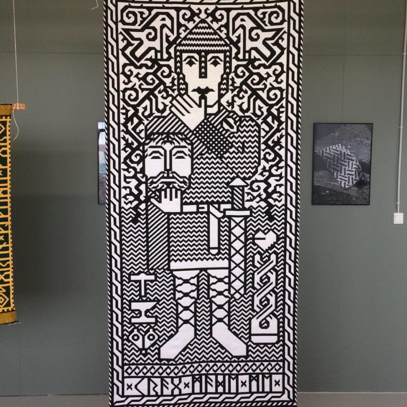 Fáfnismál (Sigurd with the head of Reginn). Digital painting. Jacquard handwoven piece(two-sided), wool. Installation: Bungee cords. Size: 105x230. Year of production: 2021. Photo credit: Søren Krag