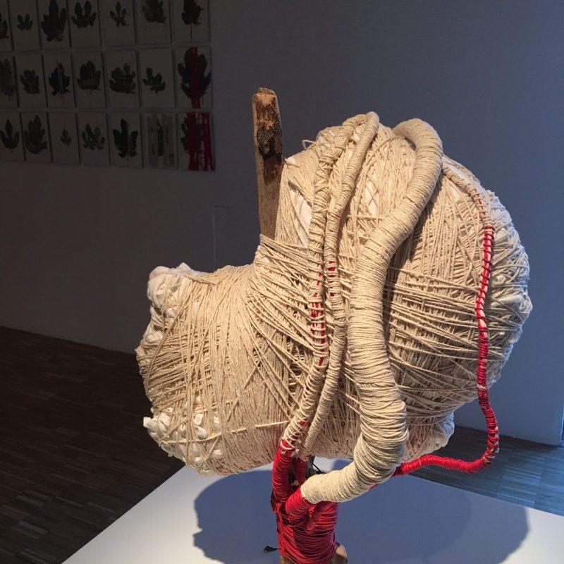 MPH, 2017, scultura tessile con bronzo e ramo d'albero, tecnica mista