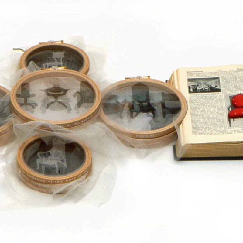"""""""Bodies of Knowledge Volume 5; Arbiters of Taste"""", 2002, 1934 Encyclopaedia, printed silk crepeline, pins, embroidery hoops, 5cm x 84cm x 34 cm, ph. cr. Michael Wicks, in the collection of Victoria and Albert Museum, copyright Caroline Bartlett"""